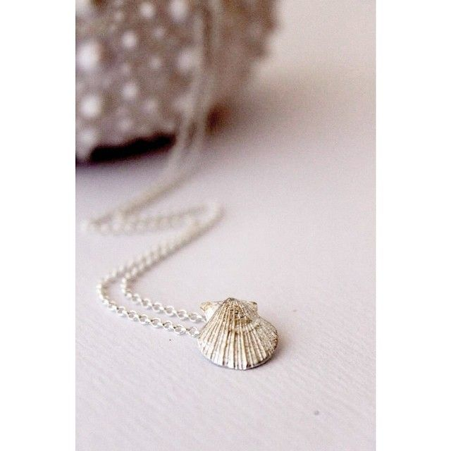 a tiny scallop found south of Ucluelet cast into fine silver forever.