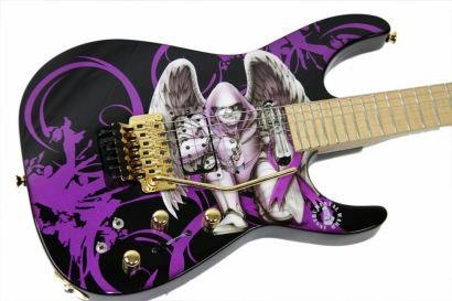 "With his support of the fight against Pancreatic Cancer, Phil Collen of Def Leppard; who lost his father to the disease, became much more than a guitar hero to me.    This is his custom-made guitar, ""Wings"". He had it made with the expressed purpose of taking it on Def Leppard's recent world tour, and then auctioning it off . The selling price of $15,000 was sweetened with $5,000 of his own, and then donated to the Gerson Institute, in honor of Pancreatic Cancer Awareness Month."