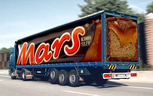 Creative truck advertisement by Mars chocolate . The King ...