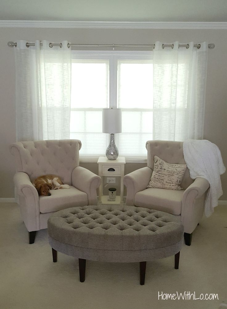 Double tufted arm chairs with tufted ottoman for a formal sitting room. Great little reading/coffee nook for the morning! More information including source list at HomeWithLo.com