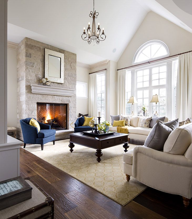 warm welcoming family room/living room by Jane Lockhart, stone fireplace
