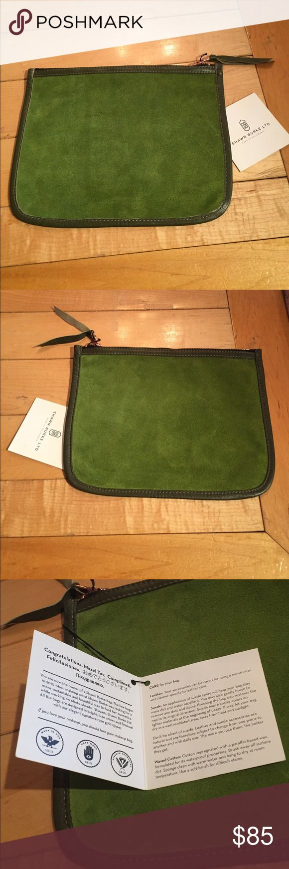 "Shawn Burke olive green suede cosmetics clutch NWT Fabulous olive green suede cosmetics or mini clutch by Shawn Burke LTD. accented with a copper zipper and leather pull this is a super chic piece! Genuine leather and made in California this bag measures  10"" wide by 8"" tall Shawn Burke LTD Bags Cosmetic Bags & Cases"