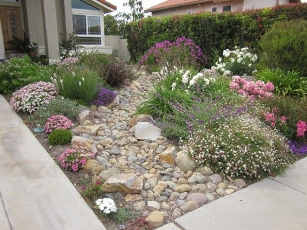 "How about NO grass and use a dry riverbed as the ""path"". Grass can go in the back yard. 28 Beautiful Small Front Yard Garden Design Ideas"