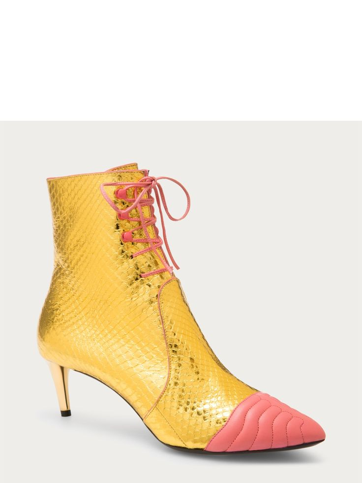 Bally MACUMBA | $795.00 | Women's snakeskin boot in gold. The elegant vintage styling of this lace-up ankle boot is elevated with gold-tone leather and a capped, pink leather toe. For effortless dressing, the Macumba employs a side zip fastener and coordinated black leather zip pull. Lace-up style, side zip fastening, ayers snakeskin, heel height: 550mm.