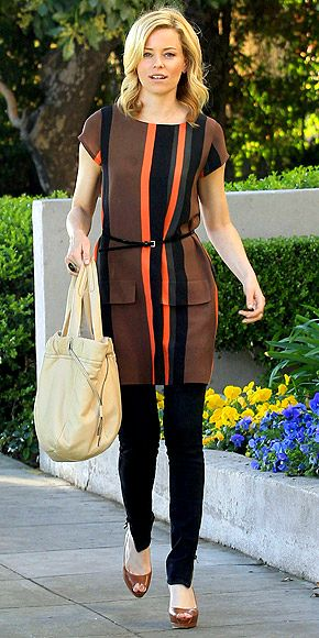 ELIZABETH BANKS  The Hunger Games star is a fashion champion in a cap-sleeve mini with external pockets that radiate retro appeal. Neutral accessories and a flippy do complete the look.