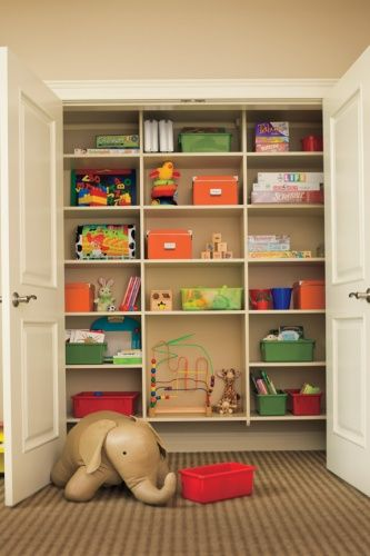 playroom closet.....just simple shelves, maybe starting at a height to accommodate the cube shelving we already have.