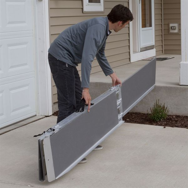 Placing portable scooter ramp on porch