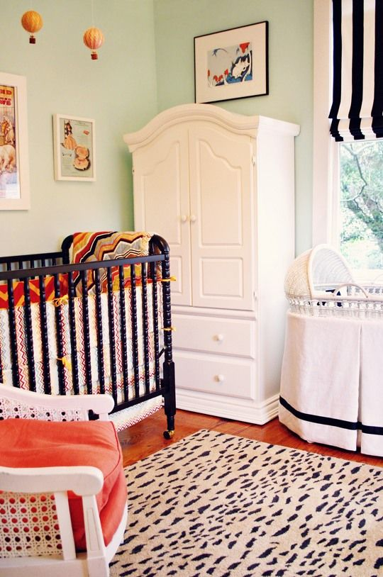 Such a cute idea for either a boy or girl! black and white striped roman shades, hot air balloon mobile, vintage circus poster. From Apt Therapy.
