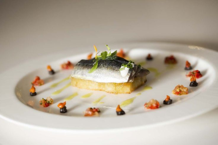 Marinated sardine with grilled bread and tapenade
