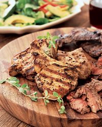 Chilean Mixed Grill. The adobo, or marinade, adds a tangy, garlicky flavor to the grilled steaks and pork chops and also tenderizes them.