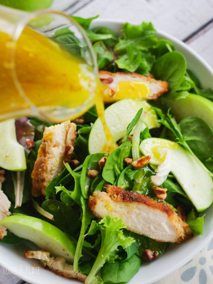 Tart Granny Smith apples, meaty pecans and breaded chunks of chicken are  topped with a homemade honey orange balsamic vinaigrette.
