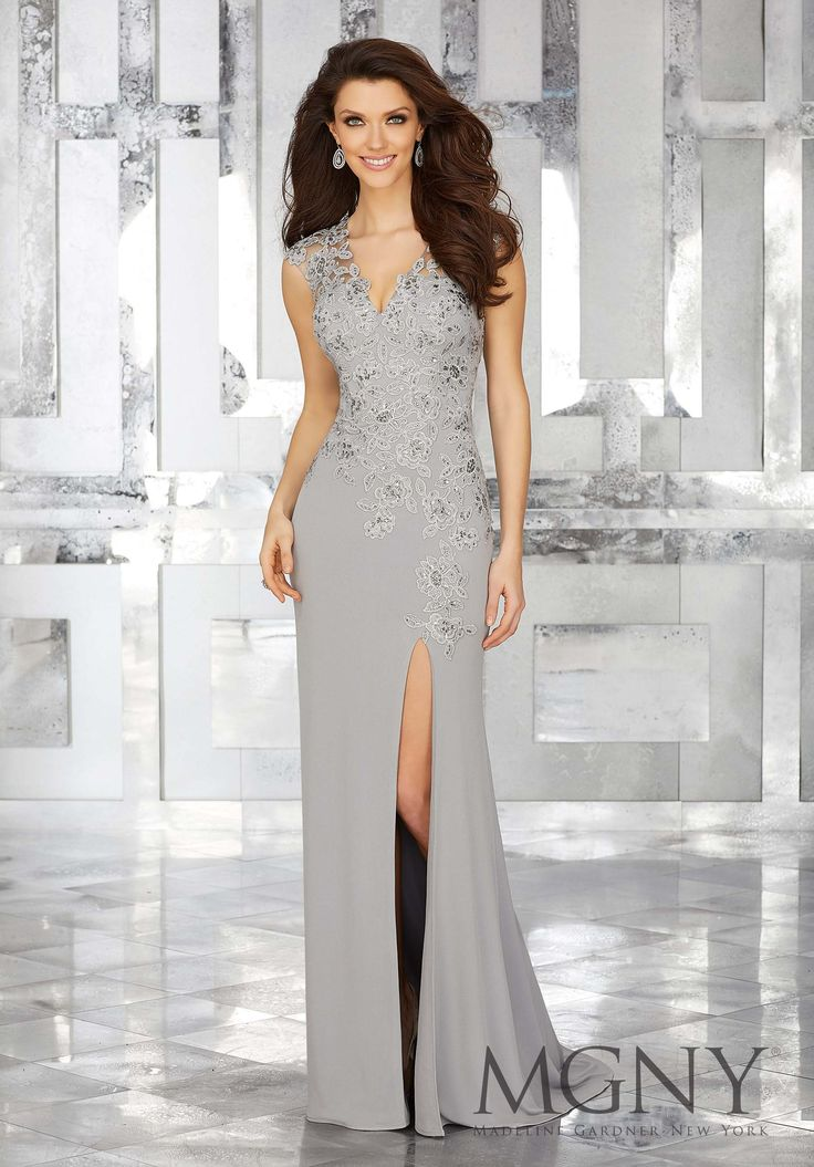 MGNY | Madeline Gardner, Evening Dress style 71627. Long and Stunning Grey Jersey Special Occasion Dress with Beaded Lace Appliques Along V Neckline and Cap Sleeves Bodice. Sheath with a Slit would be beautiful at a Fall or Winter event. Perfect for any Formal event including a Military Ball and Mother of the Bride. Colors Available: Silver Grey, Wine Red Burgundy, Black.