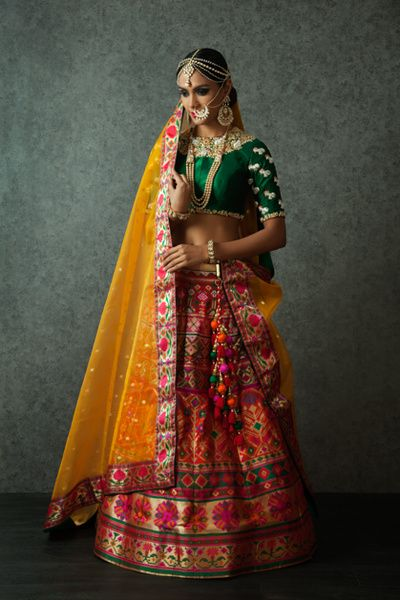 emerald green blouse, multicolored lehenga, yellow dupatta, colorful border, gold nosering