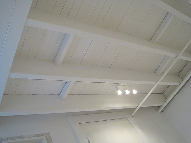 Painted basement ceiling - white. We actually did this with our paint sprayer and it totally transformed the space!