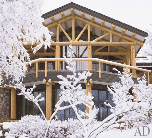 Redesigning a 20-year-old vacation home by committee can be tricky business. But when the home in question is an arresting 15,000-square-foot log cabin perched above the stylishly well-appointed town of Aspen, Colorado, and the committee is composed of three generations of a Chicago family known for their patronage of the arts, deep understanding of architecture, and taste for midcentury design, the results are a bit more certain.  In this case, a few family powwows yielded a set of…