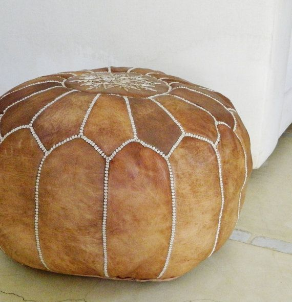 Beautiful handmade Moroccan leather pouf with beautiful embroidered design. Produced exclusively for Maison De Marrkech by skilled craftsmen in