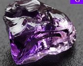 Russian Natural Rough Amethyst 7.43 ct Faceting grade  Name: Natural Rough Amethyst from Russia  Item ID: RE 535 Origin: Russia Weight: 7.43 ct Treatment: NIL Clarity: AAA perfect stone,perfect color.