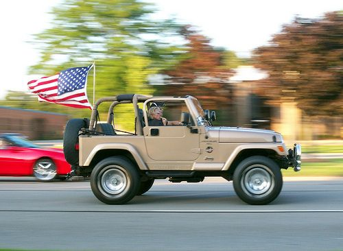 All American Jeep Wrangler (TJ) with US Flag. The Jeep brand was just named the most patriotic brand in America by USA Today.