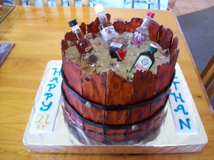Ethan's 21st cake. All edible except the booze bottles. The ice was made of vodka jelly cut into squares and the barrel was handmade chocolate stained to look like wood.