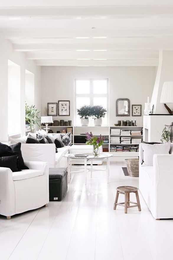 White room, touches of wood, black