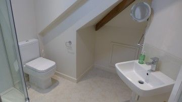 En suite bathroom n attic room - we partitioned a part of the attic room to install this small stylish shower room