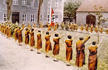 SuperStock - Nazi Germany, Junge Deutsche Madel, giving the Nazi salute, c. 1933.