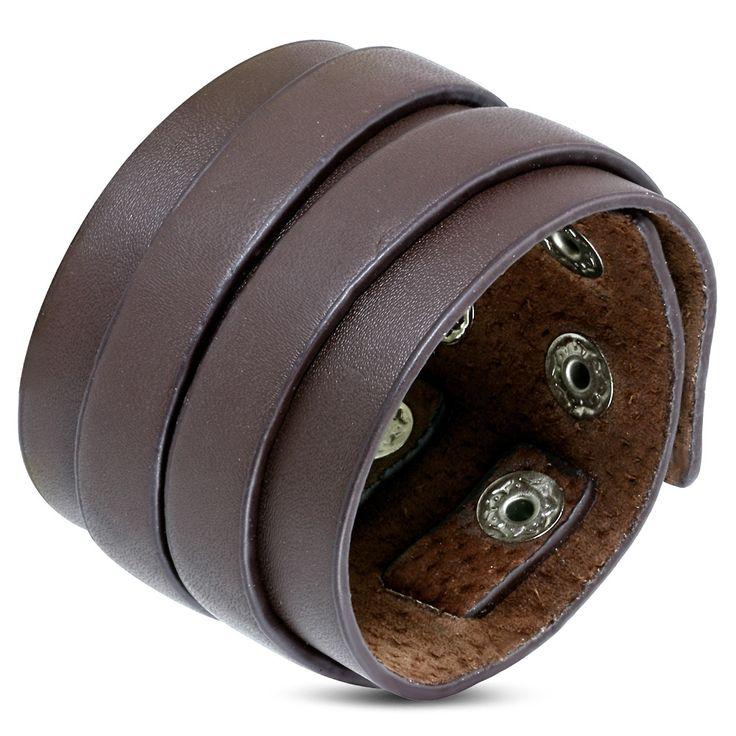 Bracelet de force Zense en cuir véritable pour homme, de couleur marron, avec deux lanières. De longueur ajustable par bouton pression, il est l'accessoire idéal des bikers, mais également un bijou très masculin pour affirmer sa personnalité. Matière : cuir. Longueur : 16,50 à 20,50 cm. Largeur : 5,0 cm. Poids : 28 g. Référence : ZB0264.