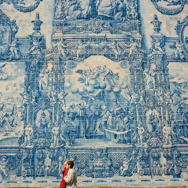 Porto, Portugal. The wall of Azulejo. The azulejo is a form of Portuguese painted, tin-glazed, ceramic tilework, that is a typical aspect of Portuguese culture.