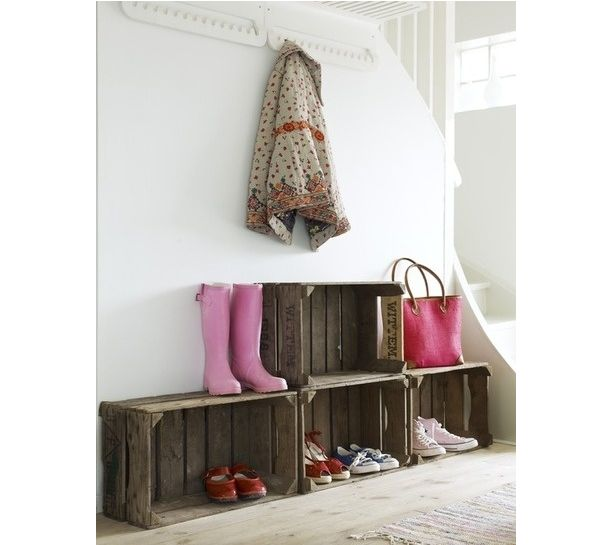 Crates stacked on each other act as easy storage. Add some hooks above to keep all the coats organized.