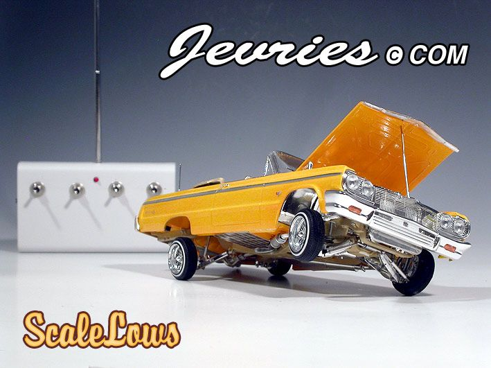 It's a 1/24 scale Revell ' 64 Impala Lowrider that is basically a crossover between a static detailled model car and an RC car. Description from cs.finescale.com. I searched for this on bing.com/images