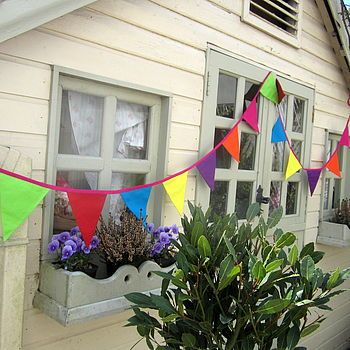 bright colourful summer bunting by the fairground | notonthehighstreet.com