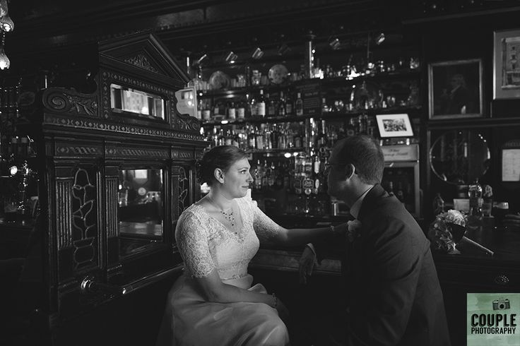 having a well earned pint and a chat in the local pub in dublin. Real Wedding by Couple Photography