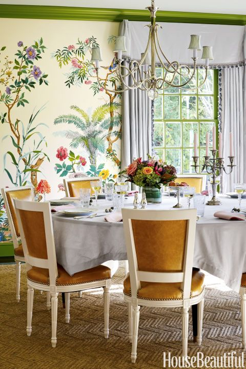 After a dramatic makeover, a Texas dining room now bursts with high-octane design, from the Zuber wallpaper to the molding's Pantone shade of Piquant Green.