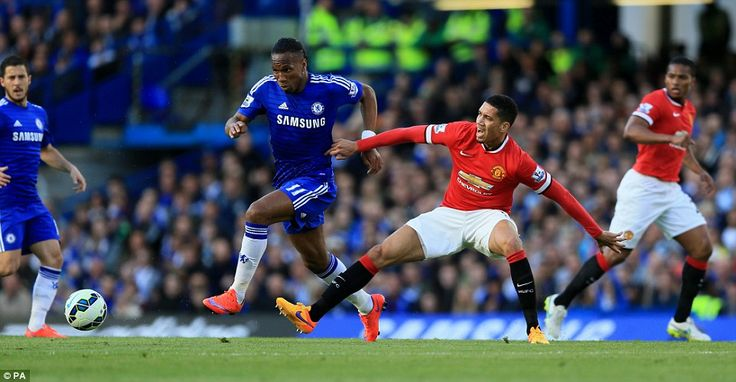 Lone striker Didier Drogba bursts past United defender Chris Smalling as Chelsea continue ...