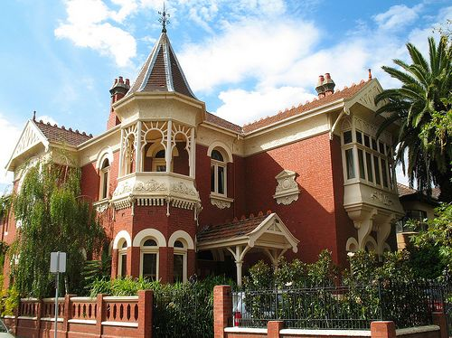 Homerton House - South Yarra...This beautiful Edwardian era, Queen Anne styled mansion, originally known as Homerton House, is located in the elite Melbourne suburb of South Yarra. Built in 1906, the red brick building features a prominent slate roofed tower with iron finial.