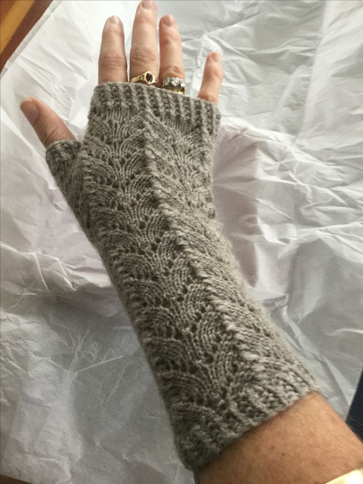 Fingerless gloves in 4 ply baby merino hand knitted in fan stitch and full broken rib. So warm!
