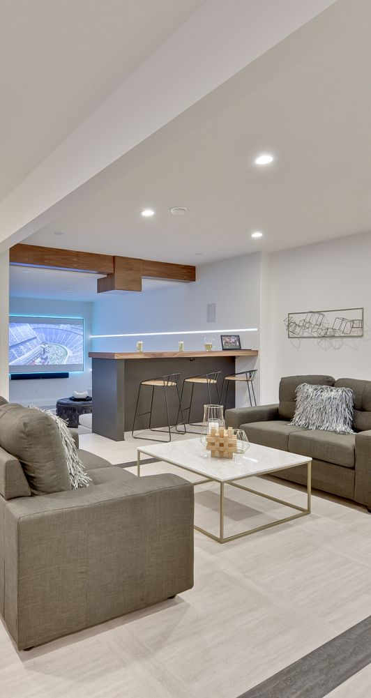 Theatre room in the basement with awesome bar. You no longer have to worry about choosing between eating those nachos and keeping the couches clean!
