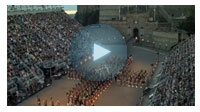 The Edinburgh Military Tattoo is a wonderful experience (I went in 2007) with military bands from all over the world in addition to BAGPIPES. It's held on the Esplanade of Edinburgh Castle.