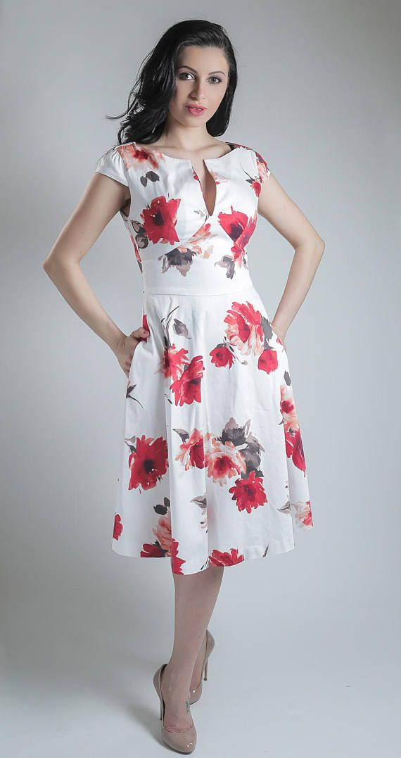 Stunning cotton summer dress in a red and coral rose print, with a fitted bodice, cap sleeves, concealed back zip, discreet side pockets, and full mid-length skirt, which will be expertly handmade to your precise measurements.  Made with cotton sateen (97% cotton, 3% spandex), it has a soft silky feel to it, with just the right amount of stretch for a better fitting. I individually check every fabric before cutting the dresses to make sure there are no flaws.  This dress has to be close…
