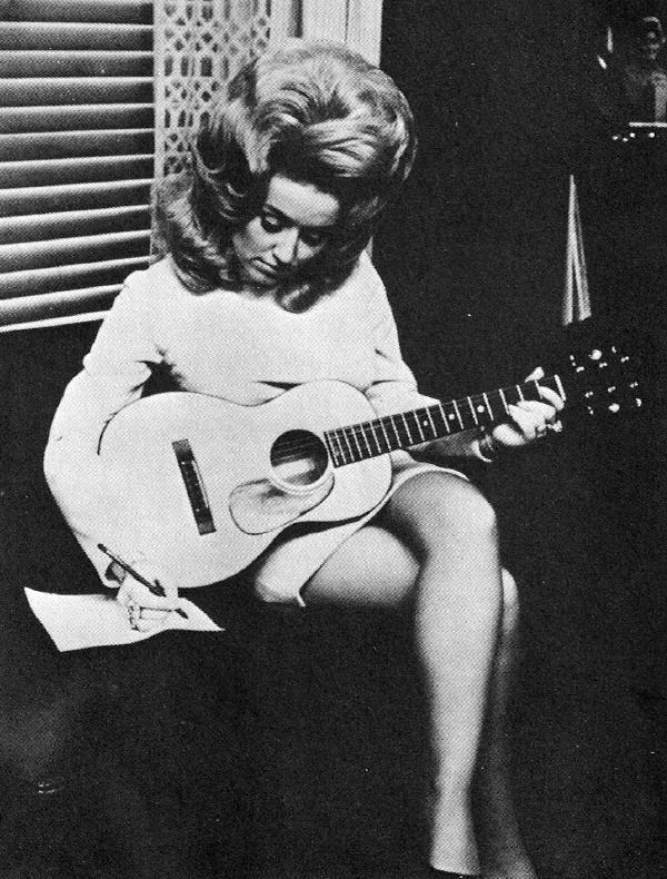Now, Dolly Parton definitely wasn't scared of big hair. She still isn't!