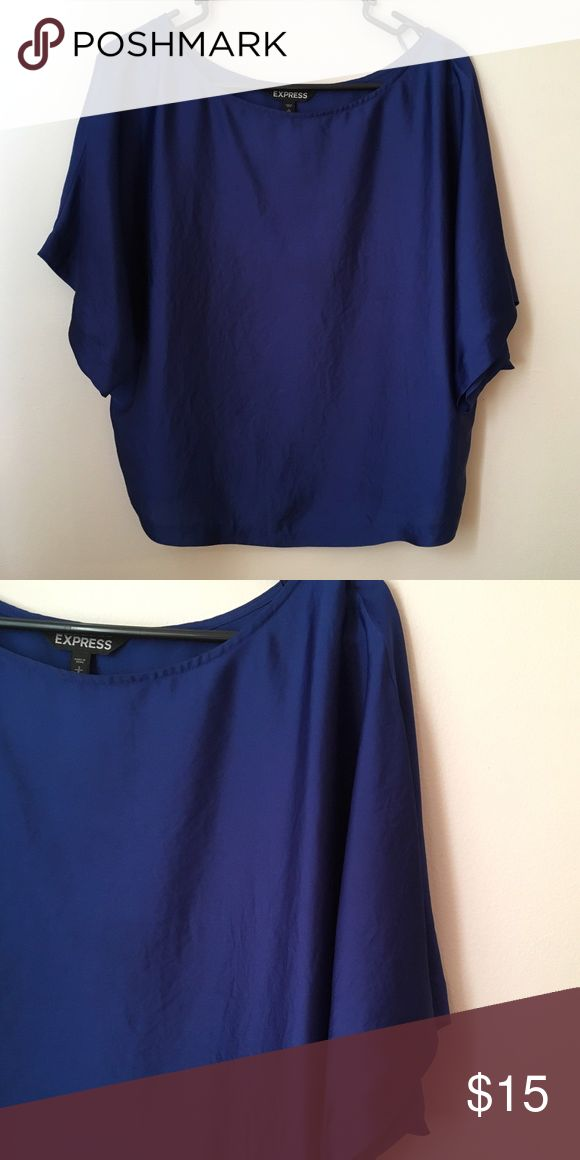Express Top Cobalt Blue Express top. Worn Once. It is a looser fitting Top that looks great dressed up with Faux leather leggings and heels! Express Tops
