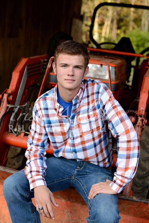 Senior guy pose. Just a boy and his tractor. Senior photo shoot farming photography