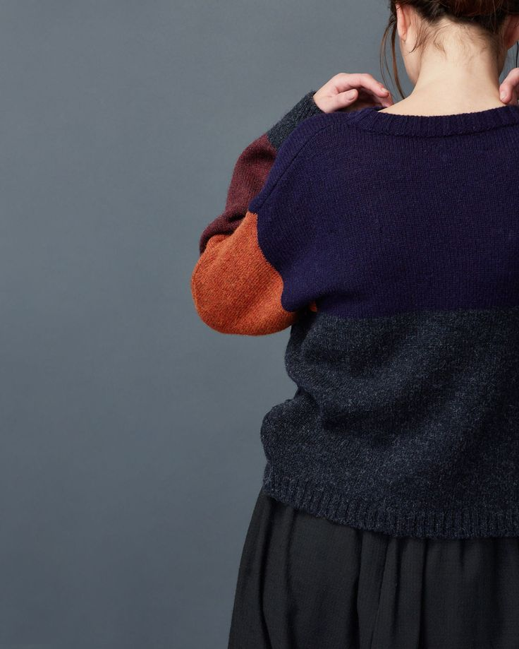 Kimono sleeved pullover in a colour blocked, heathery, traditionally spun…