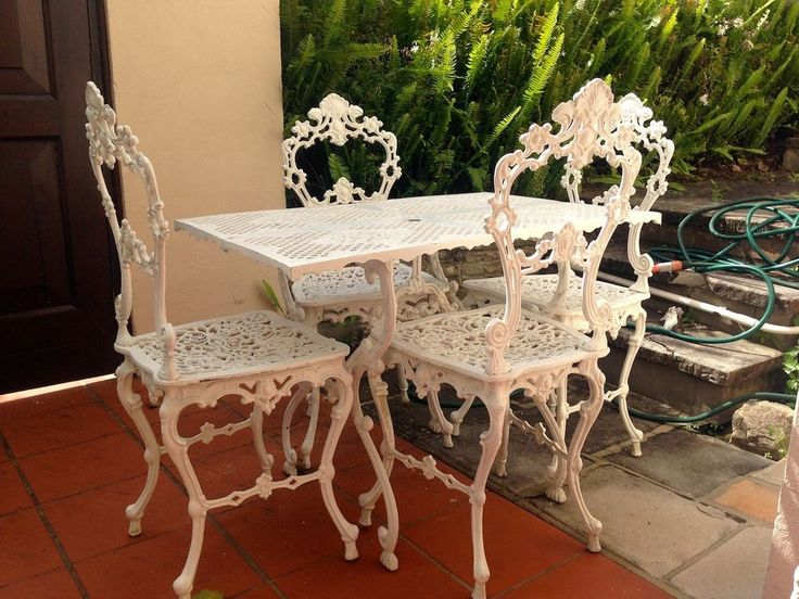 outdoor cast aluminium shabby chic bistro vintage table and chair set setting in home garden