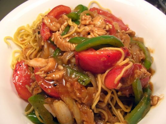 Every year during tomato season my father would drive us to San Francisco's China Town just to get a plate of Tomato Beef Chow Mein. It was only available during the peek of tomato season. This really does need good tasting tomatoes. Use fake meat