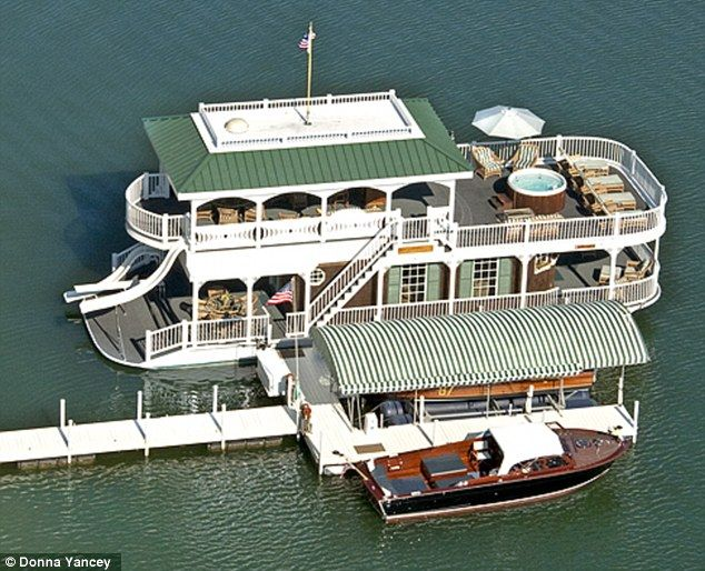 Alan Jackson's two-story houseboat that is included with his 5 million dollar home for sale.  I only want the houseboat.