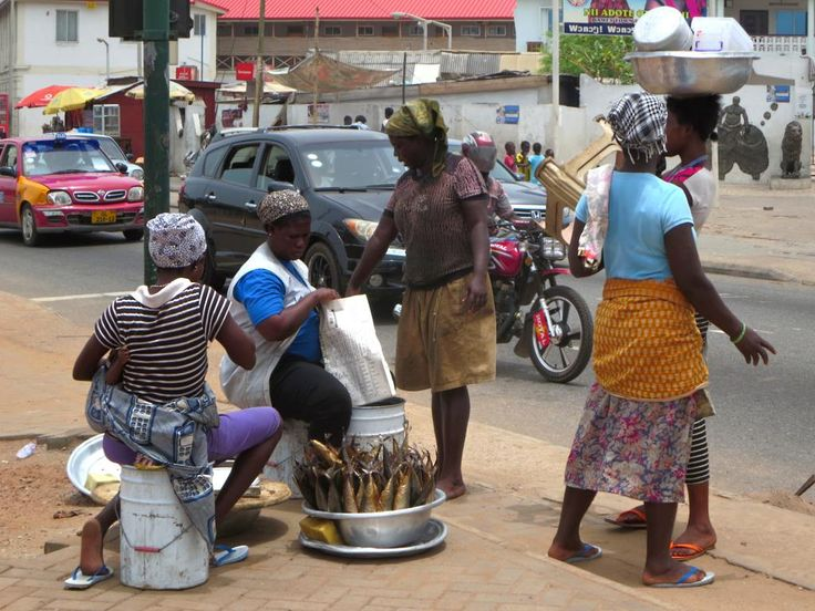 Ga women sell smoked fish by the roadside in Jamestown and Accra, Ghana.