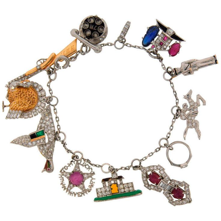 Art Deco c. 1920s Multi Gems Enamel Gold & Platinum Charm Bracelet | From a unique collection of vintage charm bracelets at http://www.1stdibs.com/jewelry/bracelets/charm-bracelets/