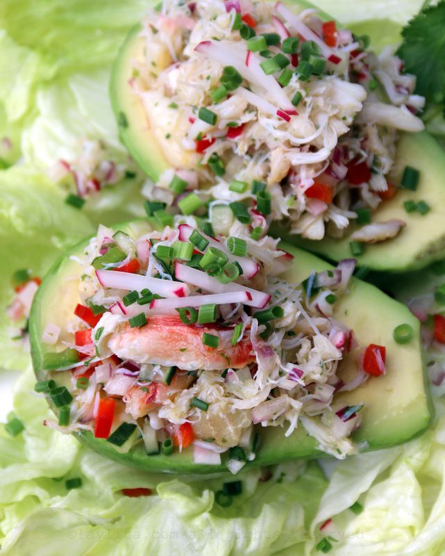 """Crab Salad Stuffed Avocados - Avocado Recipes - Laylita's Recipes..""""Crab salad stuffed avocados prepared by filling ripe avocados with a salad of crab, red onion, bell pepper, cucumber, radishes, lime juice, olive oil, and cilantro."""""""
