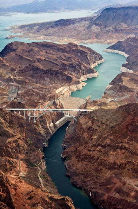 Hoover Dam. Nevada is on the left and Arizona is on the right. You cross this bridge every time you drive from Las Vegas to Phoenix, saving time as the old highway went directly over the Hoover Dam - at 15 miles per hour - or less. Tom Koebel. Luxury Voyages. 800-598-0595